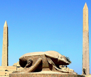 Scarab Statue and Obelisks at a Temple