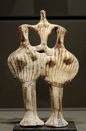 Two Phi Figurines Supporting a Tau Figurine